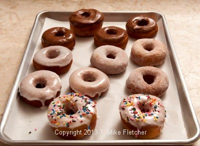 tray of iced doughnuts