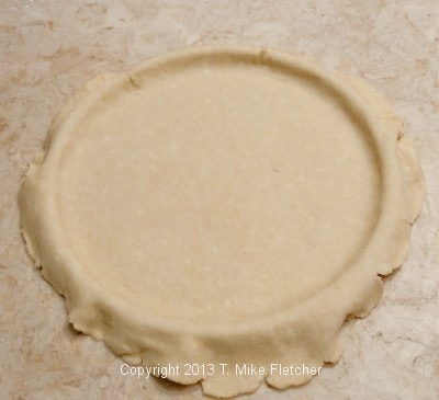 Crust overhanging pan.
