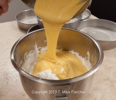 Pouring cake batter over whites