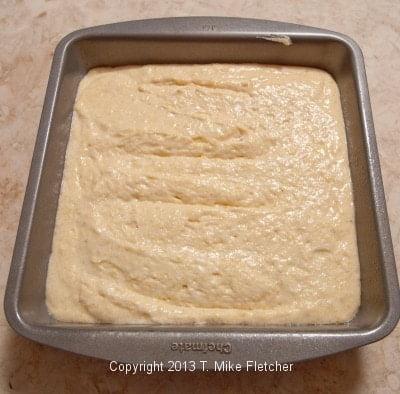 unbaked cornbread in pan