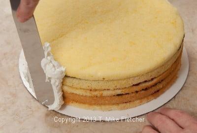 Finishing sides of cake