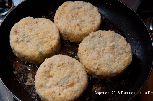 Frying risotto cakes for the Lemon Asparagus Risotto Cakes