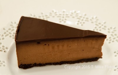 Single slice of Triple Chocolate Cheesecake