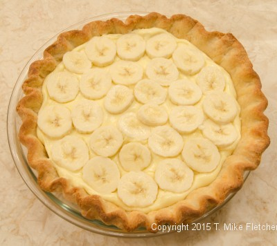 Bananas over the pastry cream for theDouble Banana Caramel Cream Pie