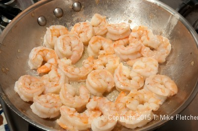Cooked shrimp in the pan for Seafood Crepes