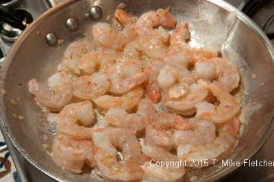 Raw shrimp in pan for Seafood Crepes