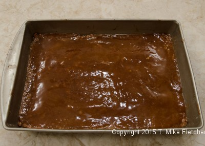 Caramel over the base of the Hazelnut Crunch Bars