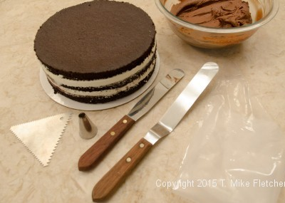 Cake and tools to finish the Double Chocolate Mousse Cake