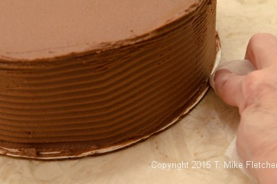 Cleaning the bottom board or the Double Chocolate Mousse Cake