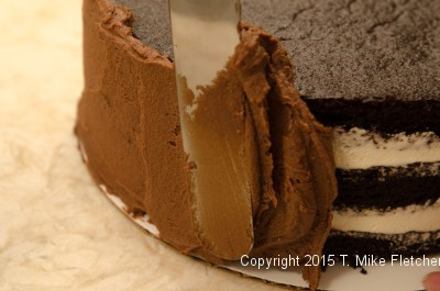Finishing the side of the Double Chocolate Mousse Cake