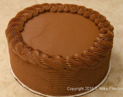 Piping the top of the cake for the Double Chocolate Mousse Cake
