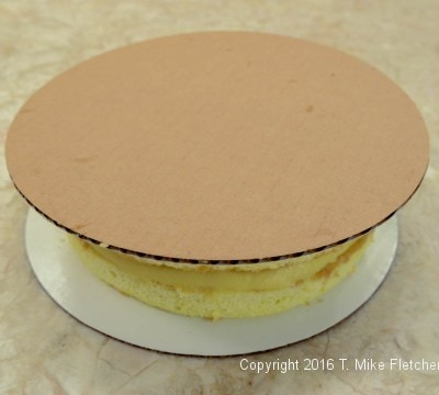Pressing cardboard on top for the Boston Cream Pie