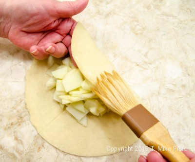 Brushing with water for Apple Crostatas with Pastry Cream