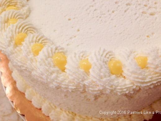 lemon-curd-in-whipped-cream-edging-for-the-lemon-blueberry-cake.jpeg