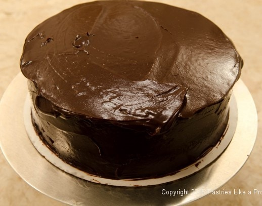 Ganache overhanging top edge of cake for Why, When and How to undercoat a cake