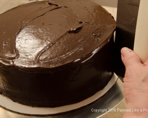 Smoothing sides of cake for Why, When and How to Undercoat a Cake