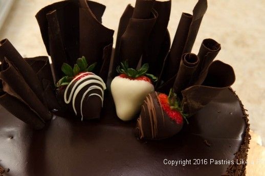 Dipped strawberries on Chocolate Strawberry Ruffle Cake