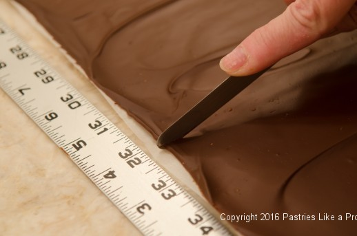 Measuring chocolate for panels for the Chocolate Raspberry Gateau