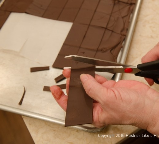 Trimming chocolate panels for the Chocolate Raspberry Gateau