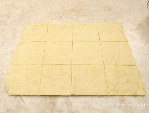 Twelve dough squares cut for Kouign Amann