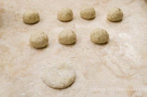 One ball of dough flattened for Garlic oregano Cracker Bread