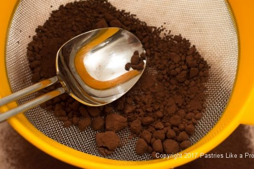 Sifting cocoa for Cocoa Fundamentlas Natural vs. Dutched