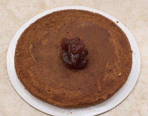 Raspberry jam on cake layer for the Chocolate Raspberry Marzipan gateau
