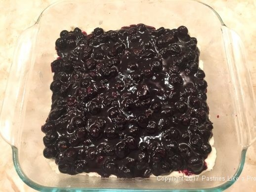 Filling spread on for the Streusel Topped Blueberry Cobbler