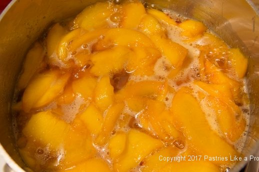 Cooked peaches for the White Wine Amaretto Peach Sauce